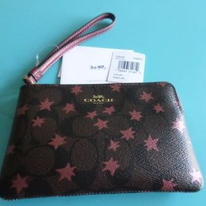 New Brown Coach wristlet with stars